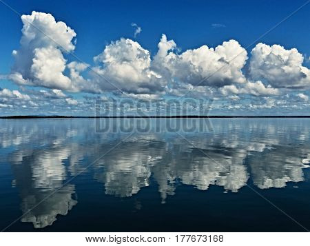 This cloud scene with blue sky and water reflections was captured in the sea between Fraser Island and the Australian mainland.