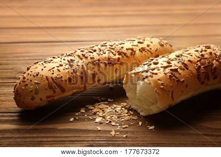 Cheesy bread sticks and crumbs on wooden table