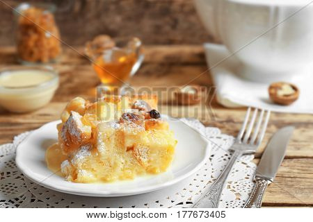 Tasty bread pudding with sugar powder on plate