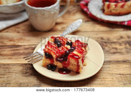 Delicious bread pudding with currant and jam on plate