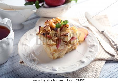 Delicious bread pudding with apple on plate