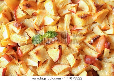 Tasty bread pudding with apples and mint, closeup