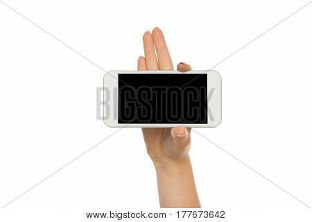 Woman hand touch mobile phone display, cutout. Female holding modern smartphone, white isolated background, copy space