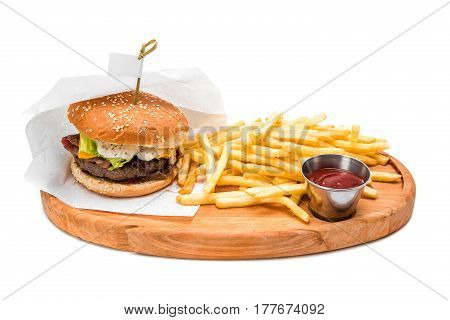 cheeseburger with fries and ketchup on wooden board