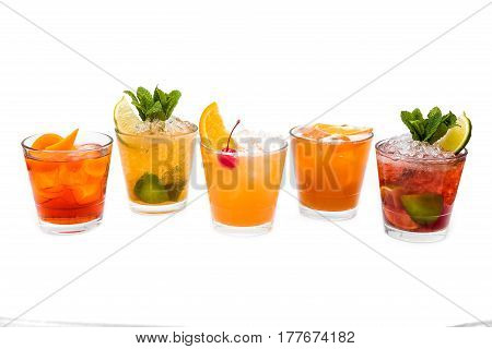 five different alcoholic cocktails shots on a white background
