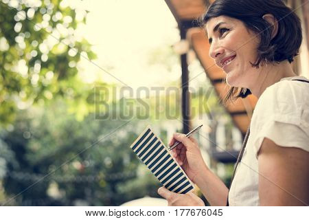 Woman holiday lifestyle writing dairy relax