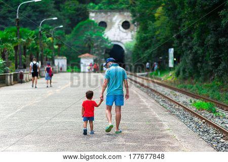 NEW ATHOS ABKHAZIA. The abandoned railway station of Psyrtskha in New Athos. family. child. tourists. tour.