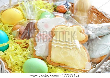 Easter basket with delicious presents, closeup