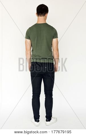 Young adult man casual rear view studio portrait