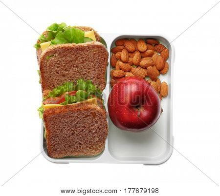 Appetizing sandwich, red apple and almond in lunch box on white background