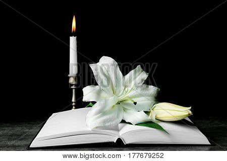 Holy Bible and Easter white lily on table