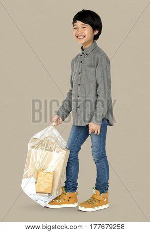 Little Boy Holding Separate Papers Studio Portrait