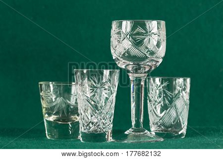 The set of a retro crystal glass on a green background