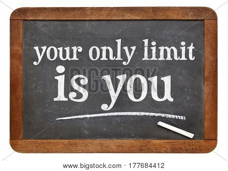 Your only limit is you - inspirational text on a slate blackboard