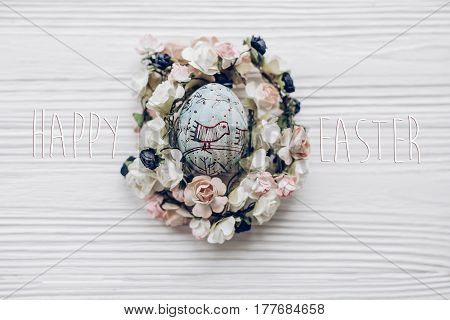 Happy Easter Text Greeting Card Sign On Easter Egg With Chick Ornaments In Floral Nest With Flowers