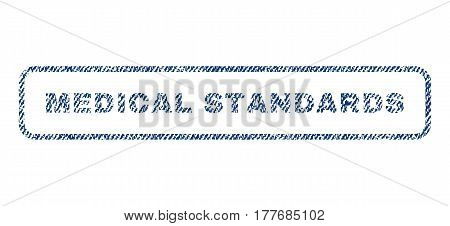 Medical Standards text textile seal stamp watermark. Blue jeans fabric vectorized texture. Vector tag inside rounded rectangular banner. Rubber sticker with fiber textile structure.