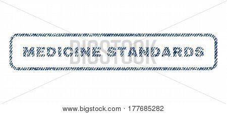 Medicine Standards text textile seal stamp watermark. Blue jeans fabric vectorized texture. Vector tag inside rounded rectangular banner. Rubber sign with fiber textile structure.