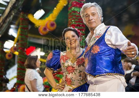 Lisbon Portugal - June 12 2014: Couple wearing costumes at the parade of popular marches (Marchas Populares) in the Saint Anthony Feast at the Liberdade Avenue (Avenida da Liberdade) in Lisbon Portugal