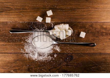 Diabetes. A lot of sugar cubes in spoon.