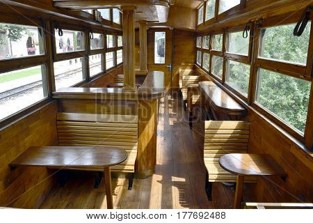 Vintage interior of old wooden railway wagons for the transport of passengers