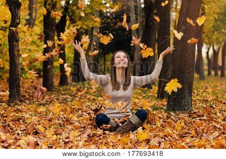 Autumn Girl Playing In City Park. Fall Woman Portrait Of Happy Lovely And Beautiful Young Woman In F