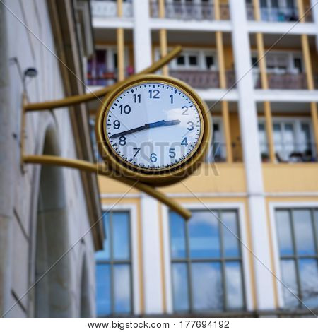 Clock on the facade of a house in Magdeburg