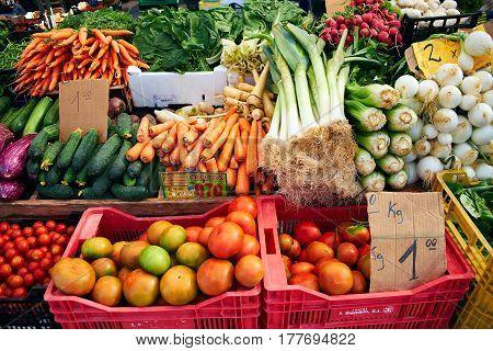 Fresh vegetables on the market. Carrots, onions, tomatoes, radishes, on Sunday market in Spain, Mercadillo de Campo de Guardamar