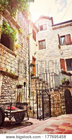Kotor Narrow Small Streets Of Historical Old Town. House Drying Linen Bright Sun Blind Old Stone. Au