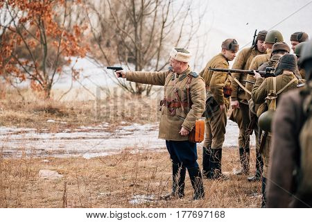 Rogachev, Belarus - February 25, 2017: Group Of Re-enactors Dressed As Russian Soviet Red Army Infantry Soldiers Of World War II Are Preparing For Historical Reenactment