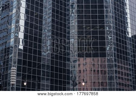 Close up majestic high-rise block reflecting houses in Unites States. Reflection concept