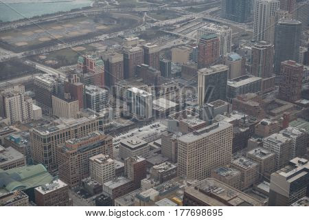Top view of city with various high-rise blocks locating near each other