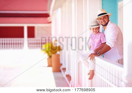 Happy Father And Son Having Fun Together Outdoors On Caribbean Street