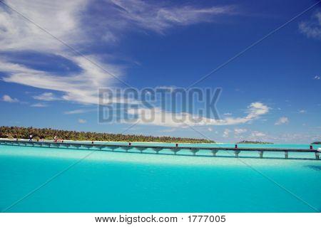 Footbridge Over Turquoise Ocean On An Maldivian Island