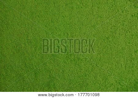 Green wool background from a piece of cloth