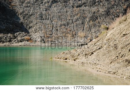 the clean water in the abandoned quarry