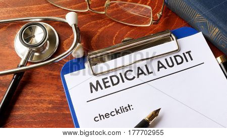 Medical audit form with checklist in a hospital.