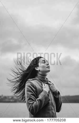 Brunette Girl Outdoor With Blowing Up Hair