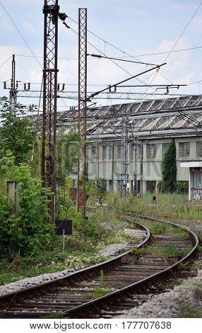 abandoned railway track with columns for electricity