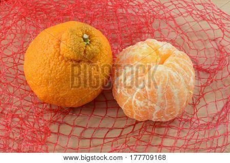 Sweet seedless peeled and unpeeled Dekopon mandarin oranges