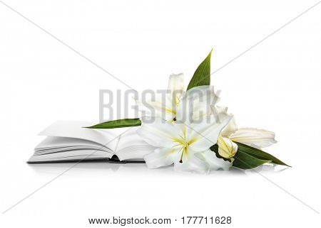 Holy Bible and Easter white lily on white background