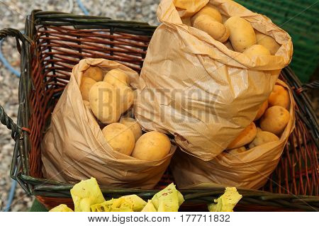 Three Bags Of Organic Potatoes For Sale In Market