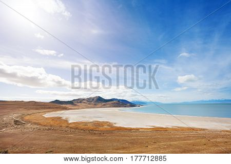 Salty lakeside of Great Salt Lake on Antelope Island at sunny day
