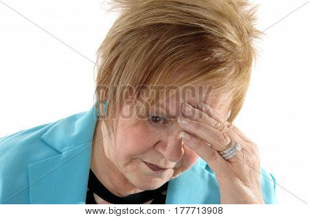 A closeup image of a lovely senior citizen woman with one hand on her forehead thinking hard isolated for white background.