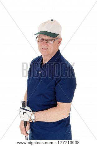 A seventy old senior standing with his white hat and blue t-shirt holding his iron in his hand isolated for white background.