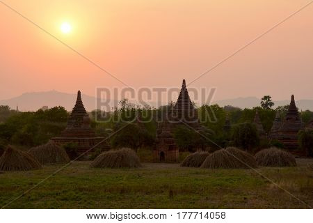 Beautiful ancient pagodas at the sunset in Bagan archaeological zone Myanmar (Burma).