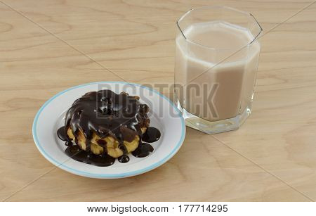 Triple chocolate breakfast with chocolate kefir and chocolate frosted donut smothered by chocolate syrup