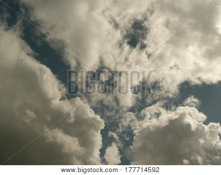 clouds after rain in sky with dramatic space between them
