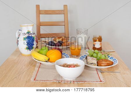 Wooden table with a rich breakfast, healthy and delicious