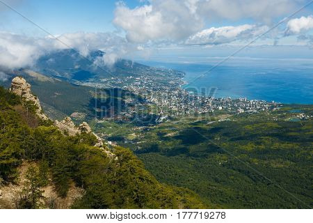 Aerial view of Yalta city from Peak of Ai-Petri mountain with cloudy sky in Crimea