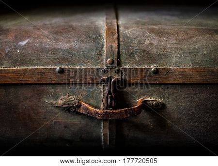 Old wooden treasure chest in the dark close up